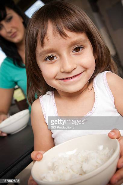 Young Girl Holding a Bowl of Rice. Relief Theme.