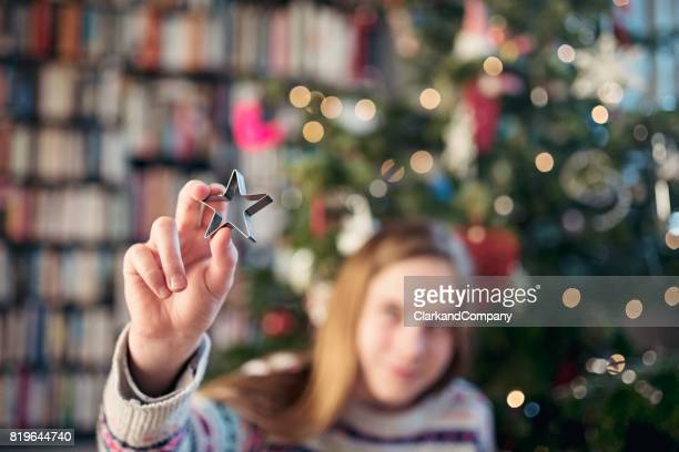 Young Girl Holding a Christmas Decoration
