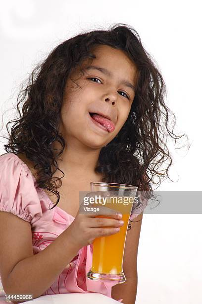 Young girl holding a glass of juice
