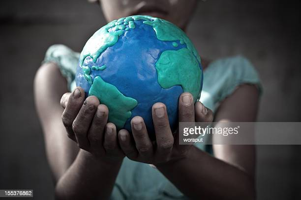 young girl holding a globe in her hands - dirty little girls photos stock pictures, royalty-free photos & images