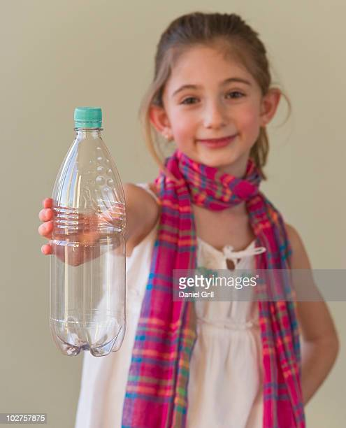 Young girl holding a plastic water bottle