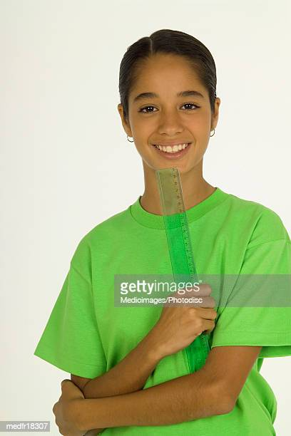 young girl holding a ruler and smiling, portrait - measuring fotografías e imágenes de stock