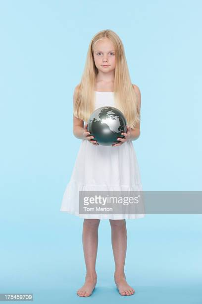 Young girl holding a silver globe