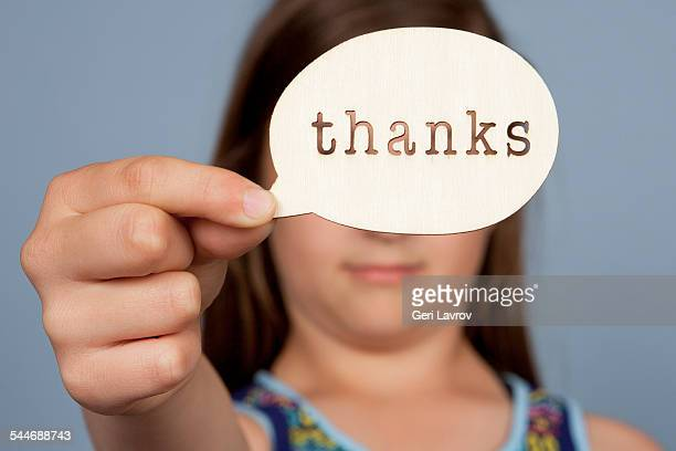 young girl holding a 'thanks' message sign - thanks quotes stock pictures, royalty-free photos & images