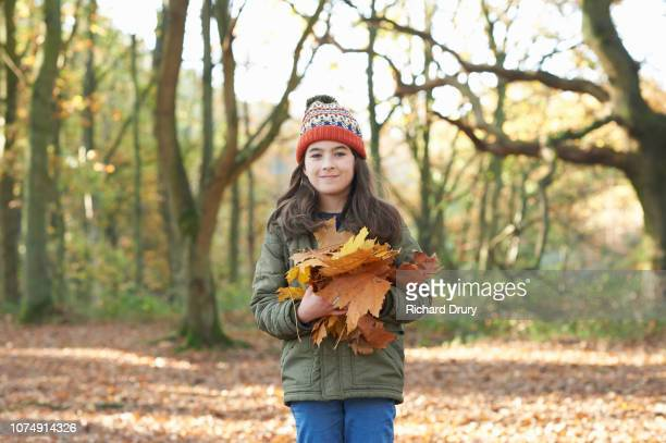 Young girl holding Autumn leaves