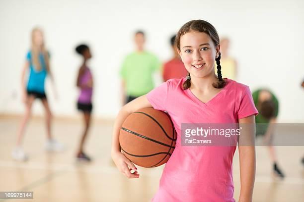 Young Girl holding basketball