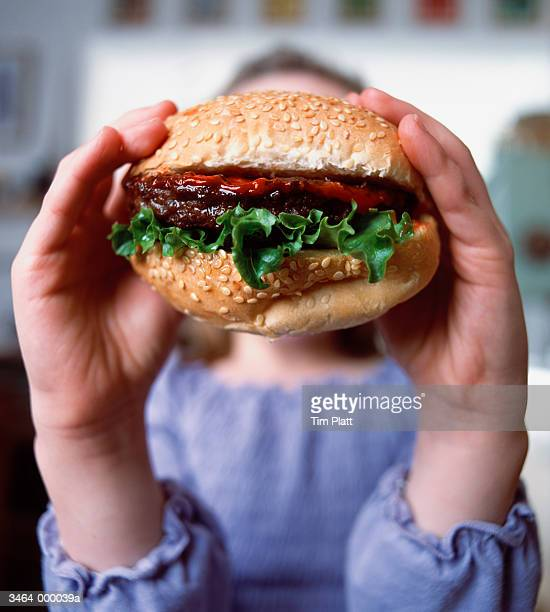 Young Girl Holding Burger