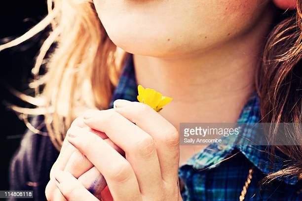 young girl holding buttercup flower - buttercup stock pictures, royalty-free photos & images