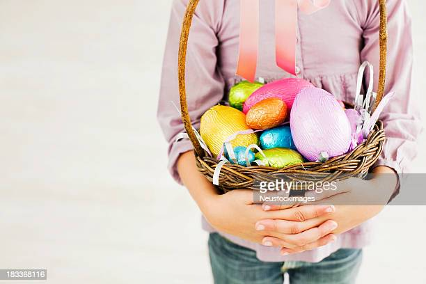 Young Girl Holding Easter Basket