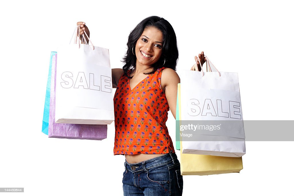 Young girl holding shopping bags : Stock Photo