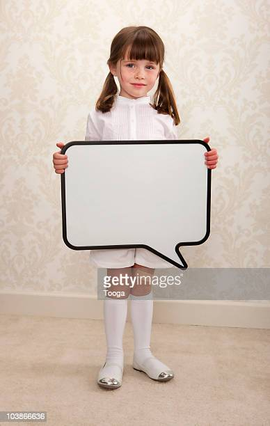 Young girl holding thought bubble sign