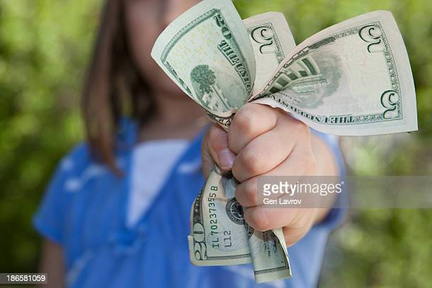 Young girl holding US currency