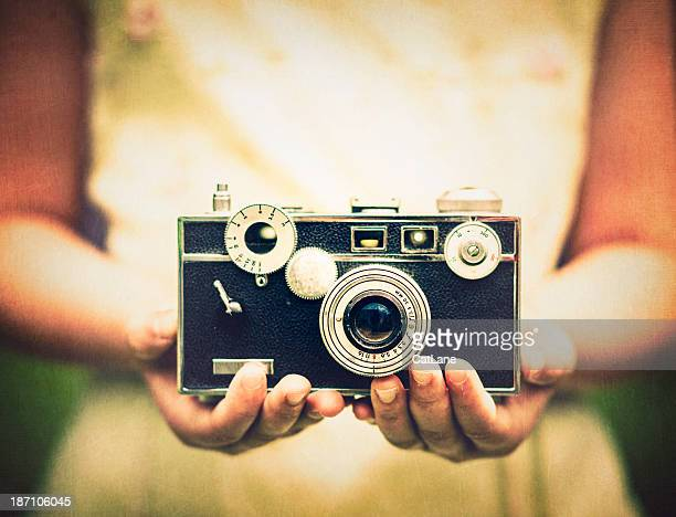 Young Girl Holding Vintage Camera