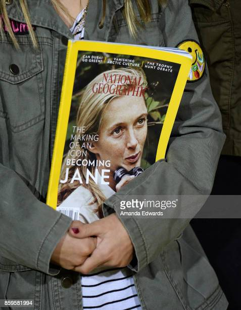 A young girl holds a copy of National Geographic Magazine featuring Dr Jane Goodall on the cover at the premiere of National Geographic Documentary...
