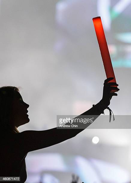 A young girl holds a glow stick during Zedd's performance at Contact Winter Music Festival at BC Place on December 27 2014 in Vancouver Canada