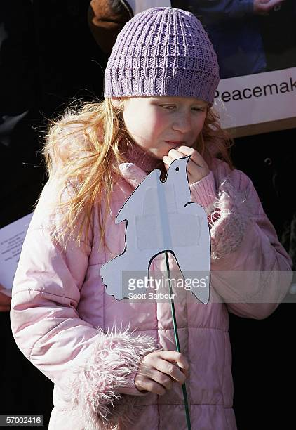 A young girl holds a paper dove during a vigil to mark one hundred days since peace activist Norman Kember was taken hostage in Iraq on March 5 2006...
