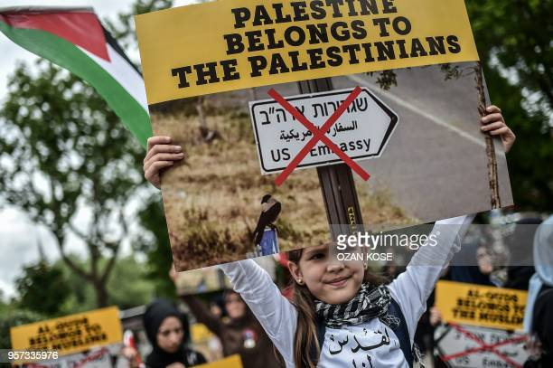 TOPSHOT A young girl holds a placard reading 'Al Quds belongs to muslims' on May 11 2018 in Istanbul during a demonstration against US President...
