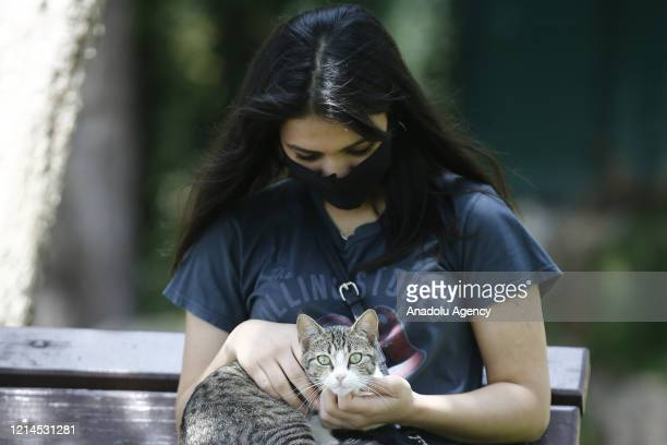 A young girl holds a stray cat after youths between 1520 years across Turkey allowed to leave their homes remaining within walking distance and...