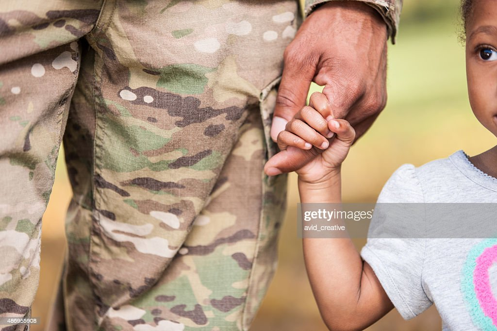 Young Girl Holds Soldier Daddy's Finger : Stock Photo