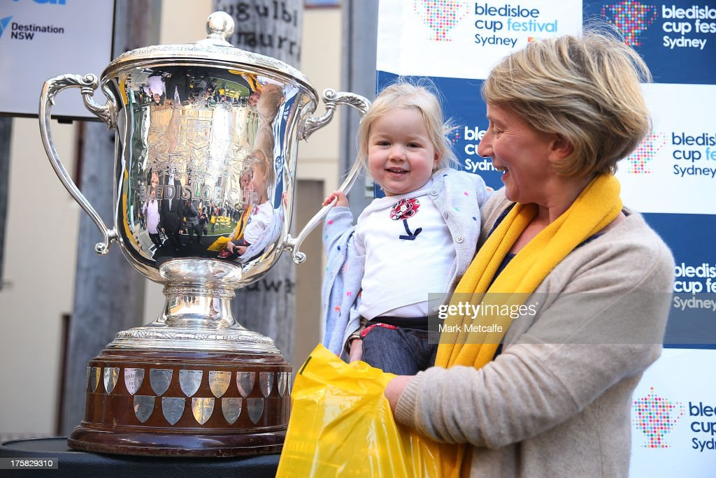 A young girl holds the Bledisloe Cup during the Australian Wallabies Bledisloe Cup launch at the Museum of Sydney on August 9, 2013 in Sydney, Australia.