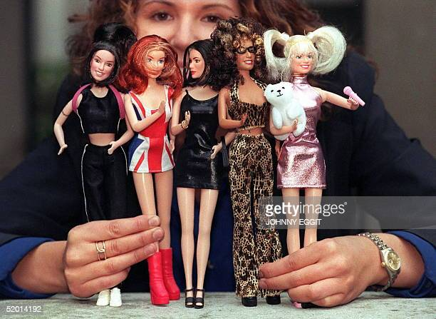 A young girl holds the Spice Girls dolls which were unveiled at the Toy Retailers Fair in London by the Character Group which has exclusive rights to...
