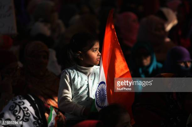 A young girl holds tricolor flag during a protest against Citizenship Amendment Act National Population Register National Register of Citizens in...