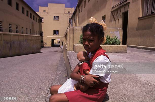 young girl hugging a doll, santiago, cuba - cuban doll stock pictures, royalty-free photos & images