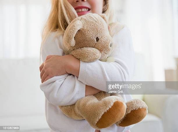 young girl hugging teddy bear - stuffed toy stock pictures, royalty-free photos & images