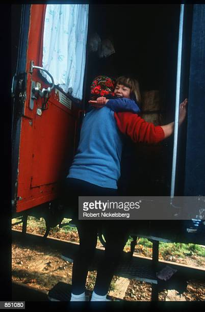 A young girl hugs her mother in a train where many Croat and Muslim refugees live December 20 1994 in BosniaHerzegovina Civil war erupted in Bosnia...