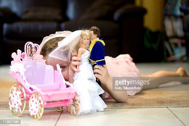 Young girl imitates the Royal wedding ceremony of Prince William and Catherine Middleton with her doll bride and groom on April 29, 2011 in...