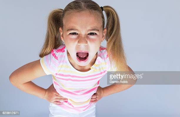 Young girl in a bad mood screaming angrily