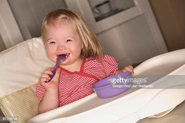 Young girl in a high chair