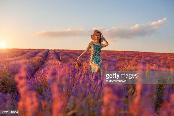 Young girl in a purple flowers of lavender