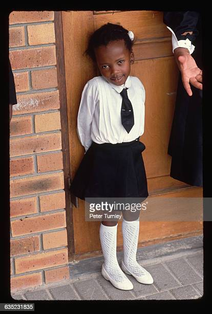 A Young Girl in a School Uniform