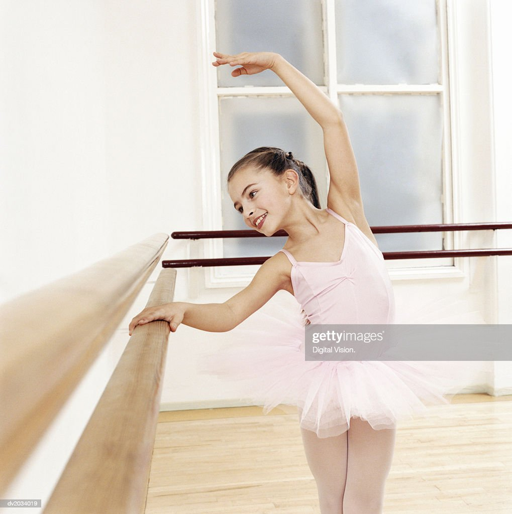Young Girl in a Tutu Practises Ballet in a Studio : Stock Photo