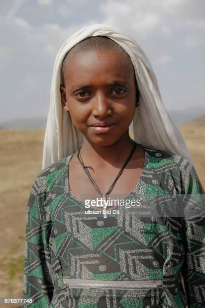 Young girl in a village by the source of the Blue Nile in the mountains near the Rift Valley in Ethiopia