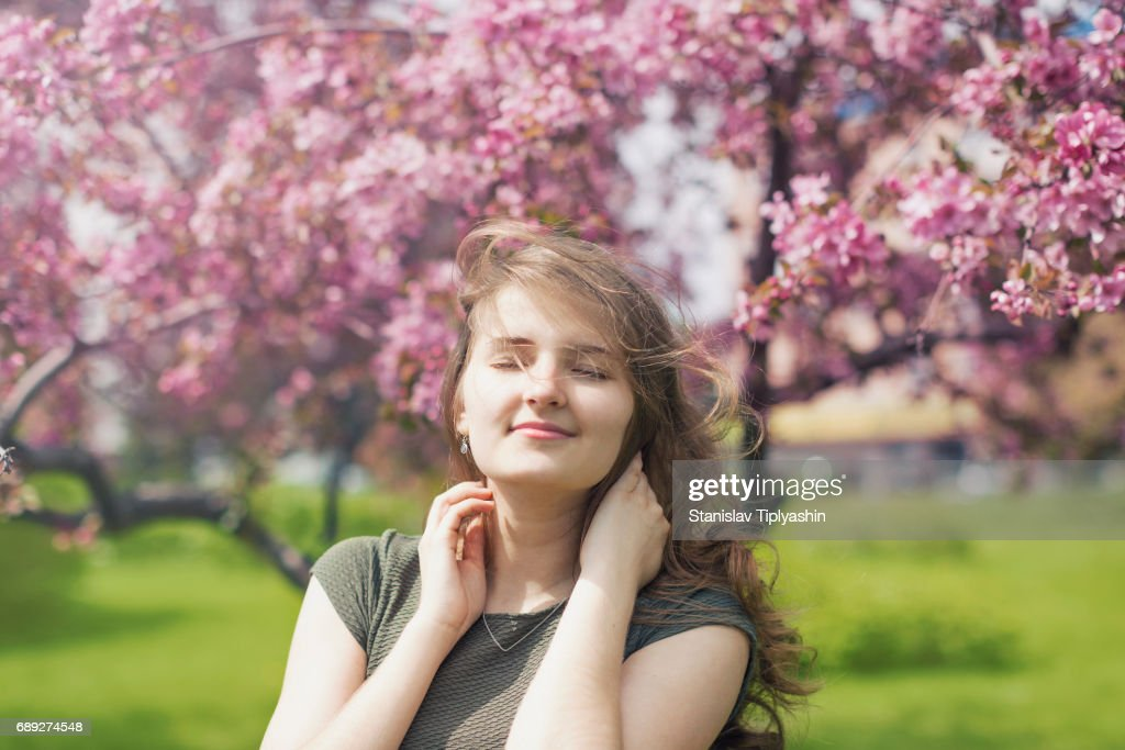Young girl in an apple orchard. : Stock Photo