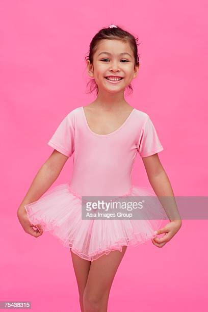 Young girl in ballerina costume, smiling at camera