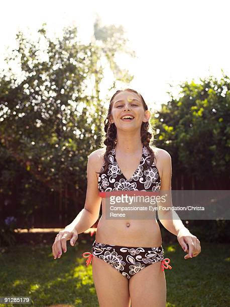young girl in bathing suit laughing