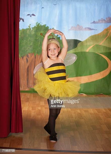 young girl in bee costume on stage - acting performance stock pictures, royalty-free photos & images