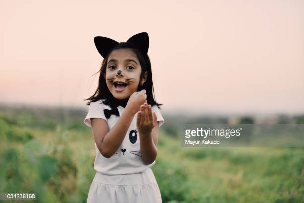 young girl in cat costume laughing - cat costume stock photos and pictures