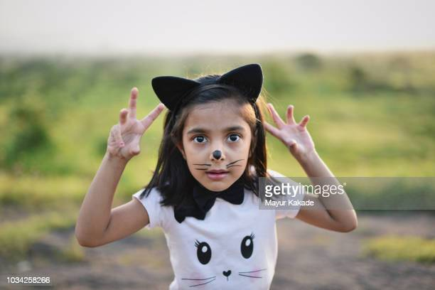 young girl in cat costume making scary expressions - cat costume stock photos and pictures