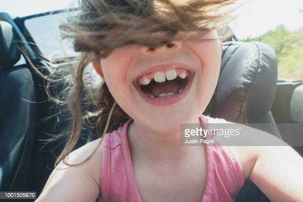 young girl in convertible car - freedom stock pictures, royalty-free photos & images