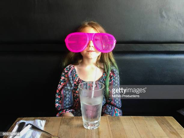 Young girl in costume glasses