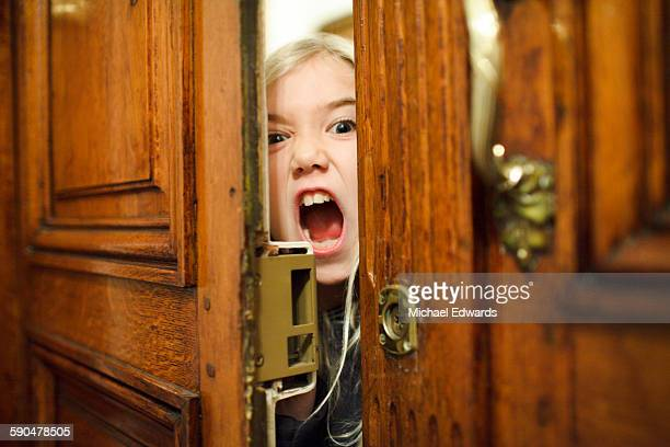 young girl in door