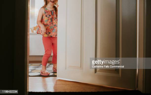young girl in doorway - gender role stock pictures, royalty-free photos & images