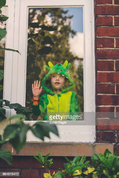 Young Girl in dragon costume - looking out of window