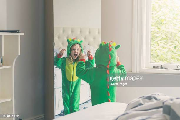 Young Girl in dragon costume - practising roar
