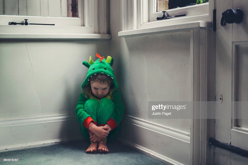 Young Girl in dragon costume - sad  Stock Photo & Young Girl In Dragon Costume Sad Stock Photo | Getty Images