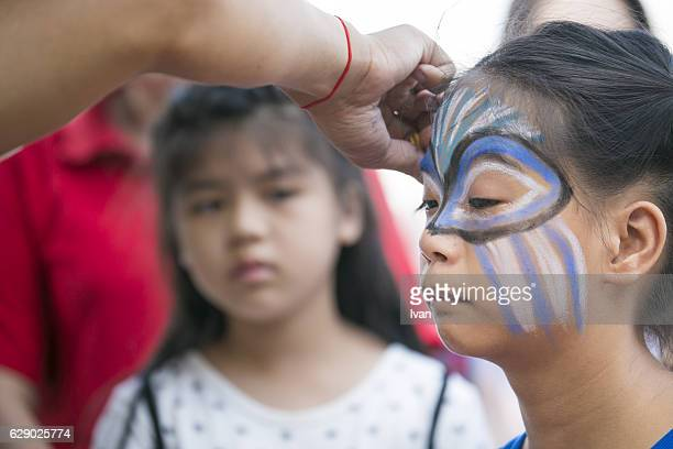 a young girl in fancy dress at a festival - parade stock pictures, royalty-free photos & images